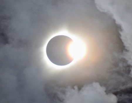 Photo of eclipse with clouds around it in 2017
